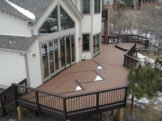 Ever wondered, what is Trex? Learn about the types of high quality building materials and products Trex has to offer to help complete any project design. Metal Barn Homes, Metal Building Homes, Pole Barn Homes, Sloped Backyard, Backyard Decks, Deck Patio, Pool Landscaping, Pole Barn House Plans, Decks And Porches