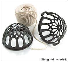 """Truly a marvel of casting quality, this reproduction Victorian string holder has been cast in steel, instead of the more fragile cast iron.  Twisting the holder halves allows them to be separated for insertion/removal of the string. The top half has an integral hang tab, allowing the holder to be hung. Once a staple item in post offices, butcher shops, or any place parcels were string wrapped.    About 4-1/2"""" tall and 4-1/2"""" wide, it works best with string balls about 3"""" x 3""""."""