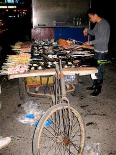 China. Food cart with seafood and greens.