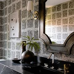 Speckled wallpaper, reminiscent of pointillism, uses black while staying light.