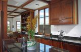 Beautifully remodeled kitchen in San Francisco 1936 Spanish Revival home. Mahogany cabinetry, coffered ceiling, Russian granite counters, stainless appliances including Wolf range, wine refrigerator. The cabinet hardware is especially fabulous!