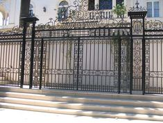 Elaborate wrought iron tall fence - protection for the garages and property. Nicely done!