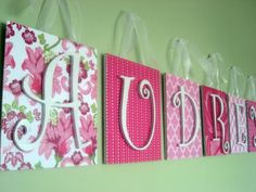 Scrapbook paper, canvas, letters.