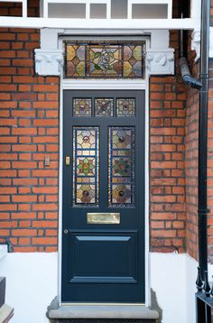 Bespoke accoya door with stain glass, frame and fan light; manufactured, fully factory finished and installed by K&D joinery for a property in London. Timber Front Door, Front Door Awning, House Front Door, Glass Front Door, Front Door Paint Colors, Painted Front Doors, Front Door Design, Victorian Townhouse, Edwardian House