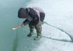 Ice fishing, photo by Michael Illuitok
