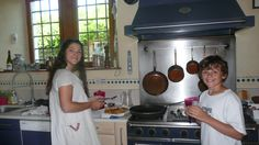 A GeoVisions Conversation Corps tutor, cooking pommes frites in her host family's kitchen.