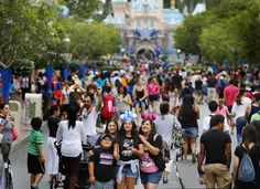 Walt Disney Co. is adopting a new pricing policy at  Disneyland  and other U.S. theme parks that would reduce ticket costs on low-demand days and boost entrance fees for more popular times.