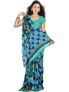 Be the most beautiful woman in a party by draping this ravishing green georgette saree. The saree features great printed designs in the body and a leafy and floral pallu enhances the look of the saree. (Slight variation in color is possible)