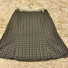 "NWOT GAP ✨ Black & Cream Skirt It's new! It's cute. It's lightweight. It's stretchy. It's the skirt from your dreams! Really it's all those things. Size 10 - see approximate measurements below.                                                21.5"" length 34"" waist (and it's stretchy) 96% Cotton, 4% Spandex Machine washable Pet free/smoke free - Clean Home! ❤️ Next day shipper - see my Posh Love Notes!    I consider offers through the offer feature, or bundle 2 items to save $$!  GAP Skirts"