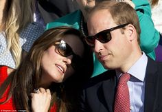 Tender moment: Kate appeared to rest her head on her husband's shoulder later in the day...