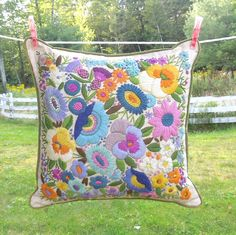 Vintage linen pillow cover with flower crewel embroidery.