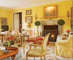 River Oaks LR in Houston TX by Mario Buatta.  Love the warm yellow with touches of coral.