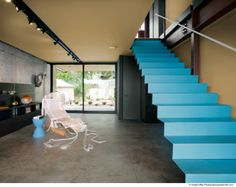 Floating folded steel plate treads and risers with an industrial textured coating. Via Fitzsimmons architecture