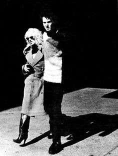 Nancy Spungen Autopsy | Nancy in long trench coat, knee high leather boots and plastic frame ...