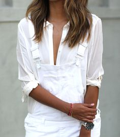 All it takes is a little buttoning to go from sophisticated to sexy. // Button-down shirt by Paige Denim