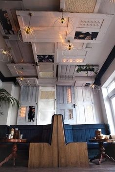 Salon sTATION MADE OUT OF OLD DOORS | design: reuse and environmental protection