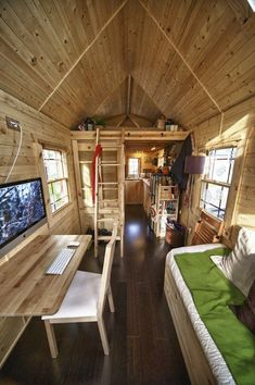 This house is 170 sq feet. Can't say that I'm in love with all of the wood grain, but it's wonderful all the same. Could you live in a space this small?