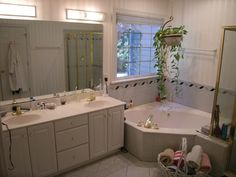 Bathroom Awesome Corner Bathtub And Vanity Double Sink Furnished With Large Mirror Bathroom Using White Furniture Ideas And Bathroom Lighting Fixtures Completed The Awesome of Bathroom Lighting Installation For Your Home