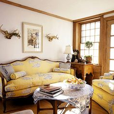 Yellow Toile-Yellow-and-blue toile is a sunny foil for the natural woodwork in the library.