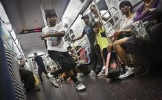 FILE - In this June 17, 2014 file photo, Marc Mack, 8, a member with the dance troupe W.A.F.F.L.E., which stands for We Are Family For Life Entertainment, performs on a subway, in New York. (AP Photo/Bebeto Matthews, File) ▼12Aug2014AP|NYC subway performers: We're being over-policed http://bigstory.ap.org/article/nyc-subway-performers-were-being-over-policed #Marc_Mack #New_York