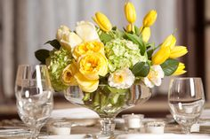 Compote floral design with hydrangeas, roses and tulips by Chuck Graham