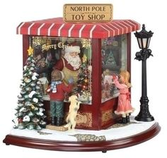 Santas North Pole Toy Shop Music Box, lights up and  plays 8 Christmas songs