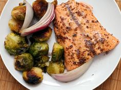 Maple and Mustard-Glazed Salmon with Roasted Brussels Sprouts Recipe Main Dishes with maple syrup, whole grain mustard, salmon fillets, brussels sprouts, purple onion, olive oil, pepper, salt, lemon wedge