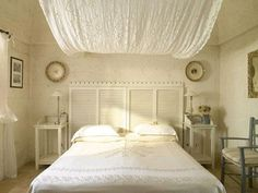 20 Cool Headboard Alternatives | Furnish Burnish ---- I have material, I want to do this in my room... over the ceiling and down the wall.