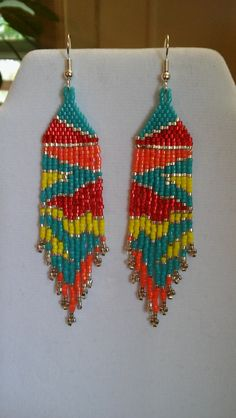 These Native American Beautifully Beaded Maze Earrings are custom made by Elaine. Made with Turquoise, Red, Orange, Yellow and Silver Delica Beads. Earrings are 3 1/2 in. long. With Silver plated ear wires on them, can be changed to post or clips. If you have any Questions just ask. Thanks for looking.