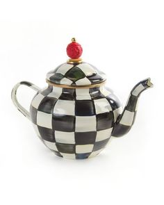 """Teapot has heavy-gauge, hand-glazed steel underbody. Hand-painted Courtly Check design. Rimmed in bronzed stainless steel. Acrylic and brass accents. Dishwasher safe; hand washing recommended. 9""""W (sp"""