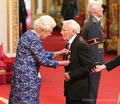 Normandy D-Day veteran Edward Slater is made an MBE by The Queen during an Investiture ceremony. 28th March 2014
