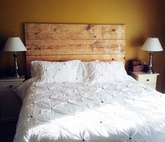 Make a painted plank headboard. I think this may truly be what I want to do. Some light stain to make it more rustic...or with pallet wood.
