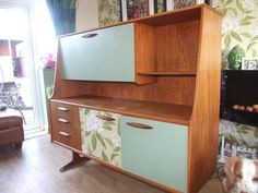 upcycle a vintage sideboard by painting drawers and/or doors in different colours, or use wallpaper.