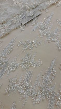 Ivory lace fabric,beaded luxury 3D lace fabric,hand beaded high quality ivory French chantilly lace fabric, sold by the yard B00158 by ImperialLace on Etsy https://www.etsy.com/nz/listing/501222889/ivory-lace-fabricbeaded-luxury-3d-lace