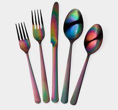 The striking rainbow finish on this darkly elegant flatware was accidentally achieved when a PVD coating process went awry. Loving the result, the ...