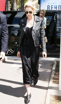 Kristen Stewart makes a black slip dress look infinitely cooler with a moto jacket and perforated loafers