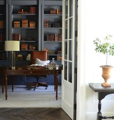 Home Office/ Library-Paint: Charcoal by Restoration Hardware.  Desk: Maitland Smith  Chair: Jeffco Lamp: HomeGoods