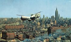 A chopper flies over Midtown Manhattan. May 1958. History New York 20th century - Page 10