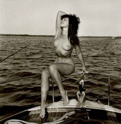 Bunny Yeager Bettie Page seated on Chris Craft hand behind head, Key Biscayne, FL | From a unique collection of photography at http://www.1stdibs.com/art/photography/