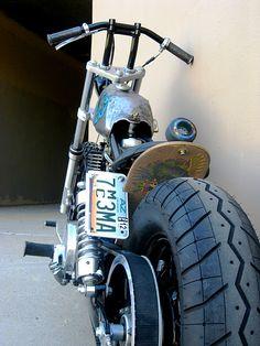 skateboard for a fender, skateboard wheel for a brake light?  genius.