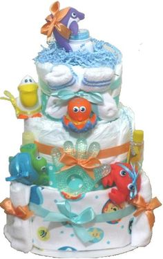www.rubysdiapercakes.com http://www.rubysdiapercakes.com/item_121/Ocean-Wonders-Baby-Diaper-Cake.htm Ocean wonders for a baby that lives on the coastline. This diaper cake has colorful bath time toys and gives the feeling of underwater bliss with the sea-green and orange colored bows. Aquatic baby shower ocean theme.