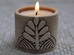 Ceramic candle holder with ornament: a bird or a herb,  for Easter Sunday. on Etsy, $7.14