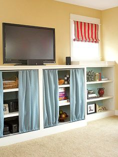 DIY Project: Suspend fabric panels from tension rods to create movable doors and conceal clutter. 13 Tips to organize your living room seating so it has a better conversational and traffic flow for family entertainment. Bookshelf Organization, Storage Organization, Home Daycare, Daycare Ideas, Living Room Red, Kids Room Wallpaper, Living Room Seating, Toy Rooms, Furniture Arrangement