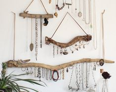 Natural driftwood turned wall mounted jewelry organizer. Create an organization and storage solution for your necklaces and bracelets by hanging a driftwood jewelry holder (or four) in an elegant display. A great gift for the wife, the mom or the you. Driftwood is a beautiful and unique material. We find ours on the shores of the Hudson River, across the way from the also and infinitely more unique and beautiful New York City. And weve turned these driftwood pieces into jewelry organizers as…