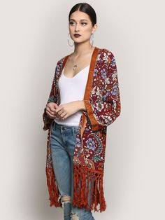"""<p>28"""" Length </p><br /> <p>21"""" Sleeve </p><br /> <p>9"""" Fringe Length </p><br /> <p>100% Polyester </p><br /> <p>Measurements taken from a size Small </p>"""