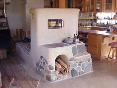 masonry wood cook stove - good article.  This is a hybrid around an antique two burner stove.