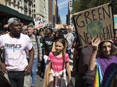 Greta Thunberg, the 16-year-old leader of a global protest against inaction on climate change, marched at a rally, September 20, 2019. Around the world, millions of other people joined her.  Photo credit: Eduardo Munoz Alvarez / AP — in New York, New York.