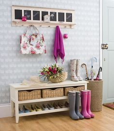 A clever use of space with a bench seat with added shoe storage, hooks for coats and bags and storage baskets for miscellaneous items to create an organised entryway