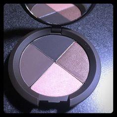 Becca eyeshadow quad in Galatica  BECCA eye shadow quad. Shades: matte ebony, metallic brown, metallic peach, and dark matte brown. Never used, still in original packaging. BECCA Makeup Eyeshadow
