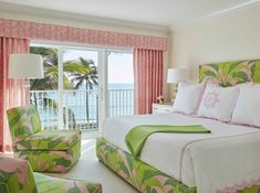 Charming pink and green cottage bedroom with an ocean view boasts a green and pink palm leaf print fabric bed dressed in pink scalloped bedding with matching shams. Glam Master Bedroom, Beach House Bedroom, Bedroom Decor, Bedroom Inspo, Girls Bedroom, Master Bathroom, Bedroom Ideas, Green Headboard, Palm Beach Decor